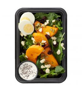 Autumn Cobb Salad: Antioxidant-rich power greens topped with roasted butternut squash, a sliced hardboiled egg, crumbled white cheddar, sweet dried cherries & crunchy pepitas, served with a side of our light lemon-chia dressing.