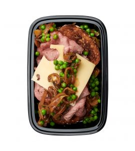 Open-Faced Roast Beef: Thinly sliced roasted top round piled on two pieces of Dave's Killer 21 whole grain bread, topped with Swiss cheese and sautéed mushrooms, onions and peas in a rich brown sauce.