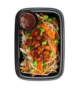 Thai Peanut Bowl: Whole wheat noodles tossed with a medley of Asian vegetables, topped with roasted sweet potatoes and edamame served with a side of our homemade sweet Thai peanut sauce.