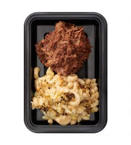 Texas Beef: Tender shredded beef tossed in our famous BRO-BQ sauce served with gluten-free roasted cauliflower mac & cheese.