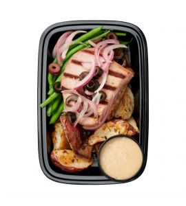Tuna Steak Nicoise: A lightly seasoned fresh filet of tuna grilled to perfection, served with oven-roasted red potatoes, steamed green beans, sliced black olives and shaved red onions and a side of our homemade Nicoise vinaigrette dressing.